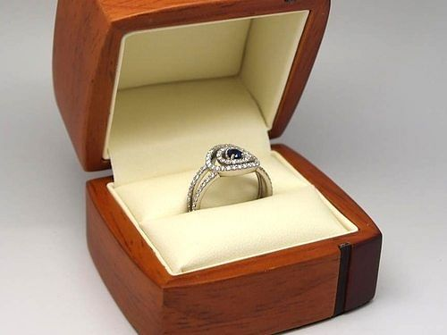 Unique sapphire and diamond engagement ring
