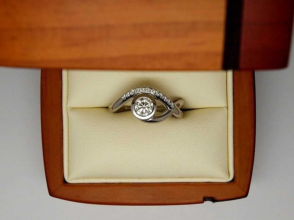 Asymmetric design engagement ring