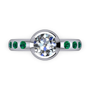 Part bezel set diamond and emerald ring