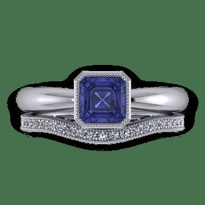 Millgrain and diamond set wedding band