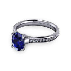 Oval sapphire commitment ring with accent set shoulders