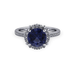Vintage white gold sapphire and diamond bespoke halo engagement ring