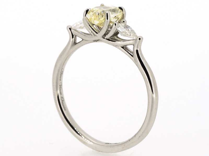 Three stone yellow diamond ring
