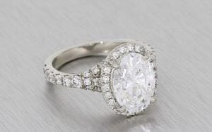 A Striking Oval Diamond Housed In A Stunning Diamond Halo