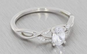 Organic Oval diamond crossover engagement ring - Portfolio