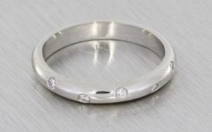 Classic platinum band with asymmetric set diamonds