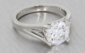 A unique platinum round brilliant cut engagement ring