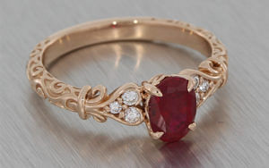 14ct Rose gold oval ruby and diamond ring