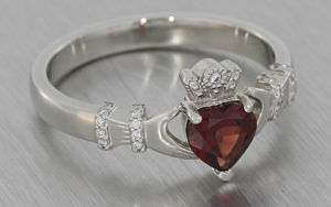 Platinum claddagh ring set with a garnet and diamonds