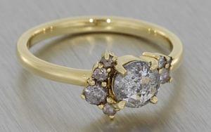 Asymetrical salt and pepper diamond ring