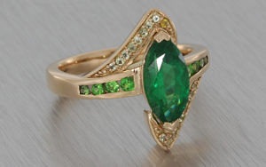 Unusual emerald and rose gold engagement ring
