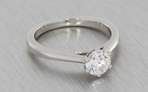 Platinum Round brilliant diamond ring with a matching diamond wedding band