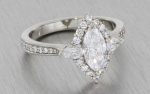 Platinum marquise ring with a round brilliant and pear shape diamod halo