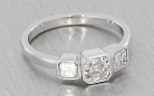 White gold and asscher cut diamond contemporary trilogy ring