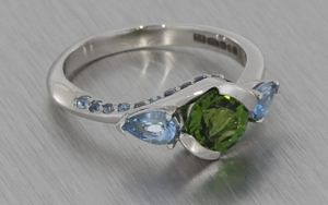 Platinum and Tourmaline trilogy with added shoulder stones