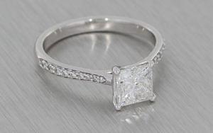 Platinum Princess cut diamond ring with diamond pave shoulders