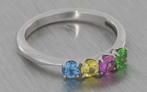 18K ring set with sapphires, topaz and garnet