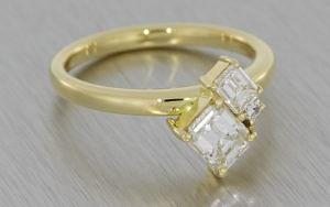 Contemporary three stone diamond ring