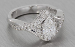 Pear diamond halo engagement ring with organic detail